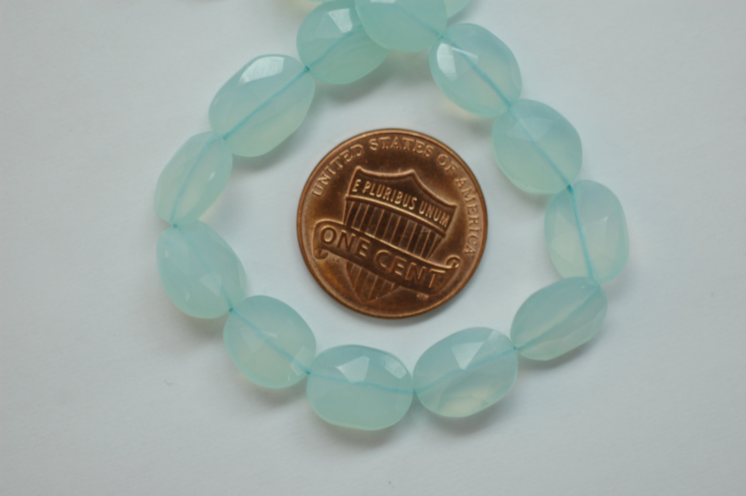 Aqua Chalcedony Straight Drill Oval Faceted