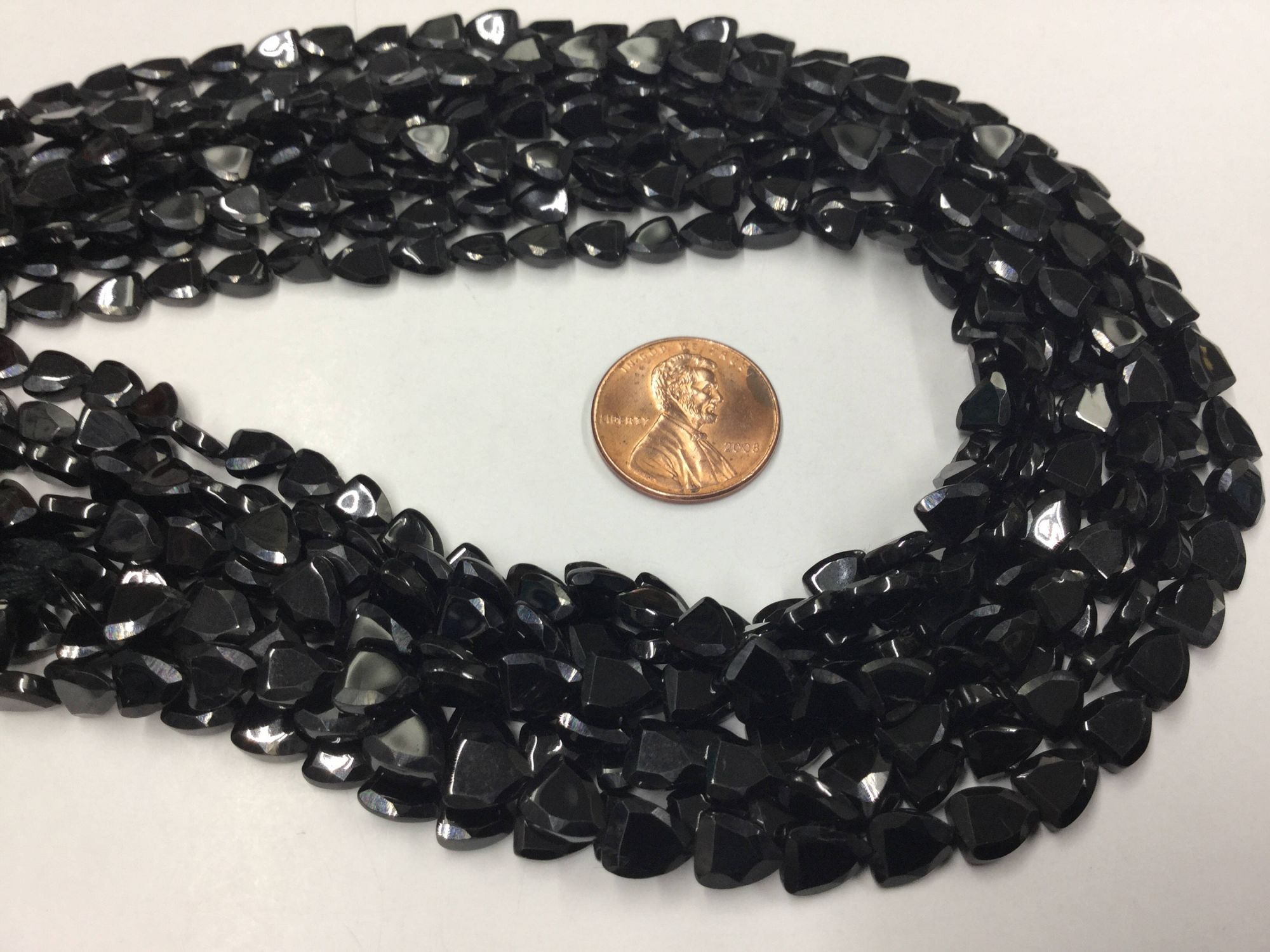 Black Spinal Straight Drilled Trillions Faceted