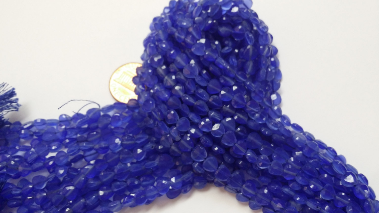 Blue Straight Drilled Hearts Faceted