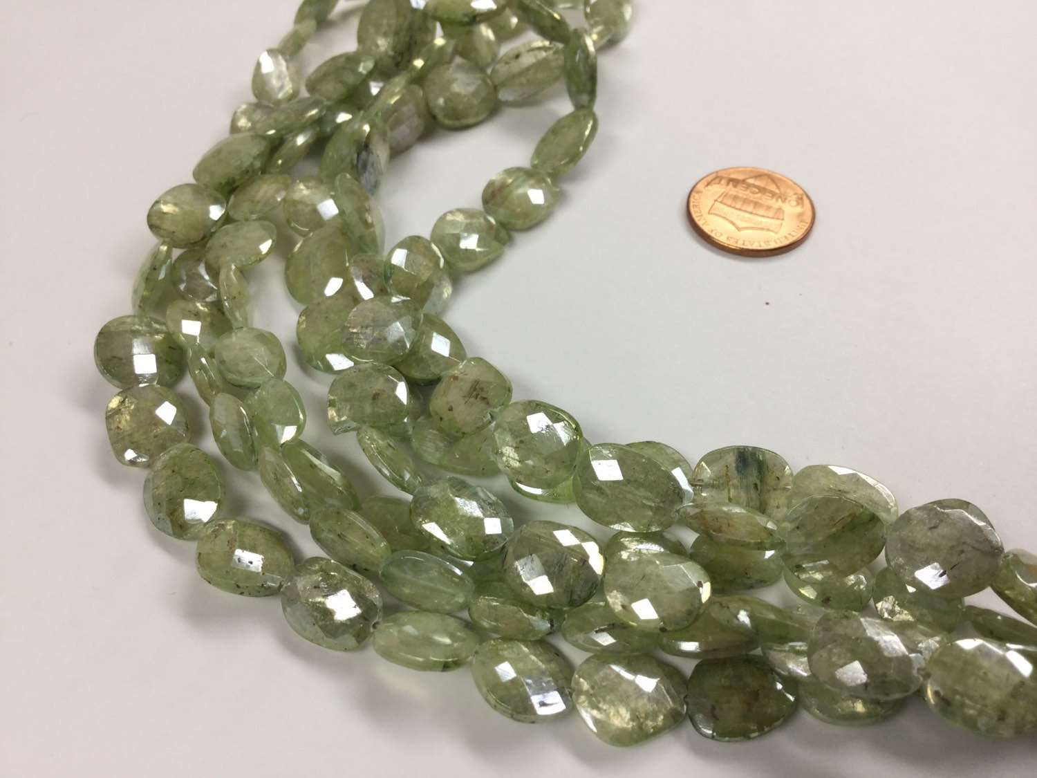 Coated Green Kyanite Ovals Faceted