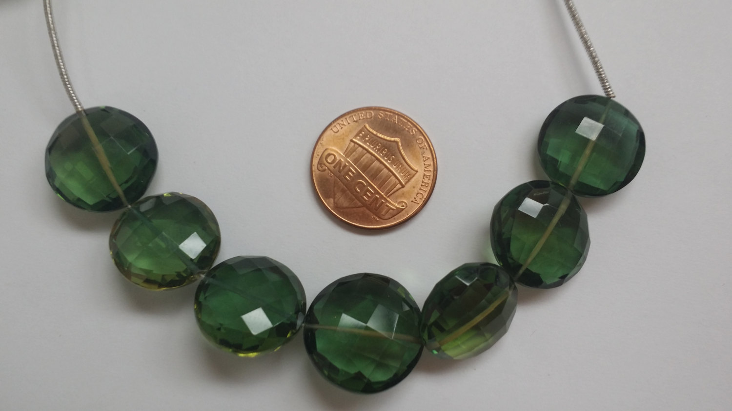Green Coins Faceted