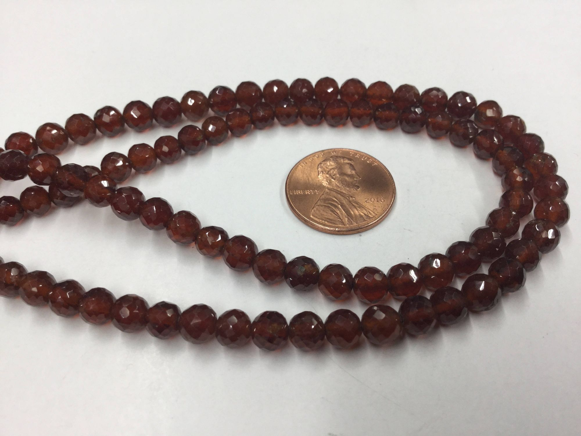 Hessonite Garnet Rounds Faceted