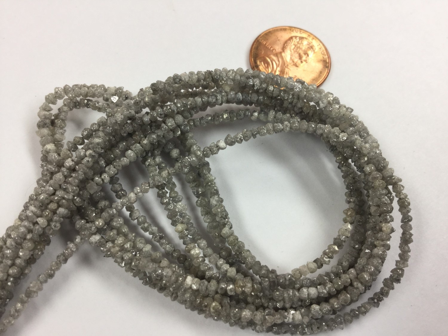 Light Grey Rough Cut Diamonds Faceted