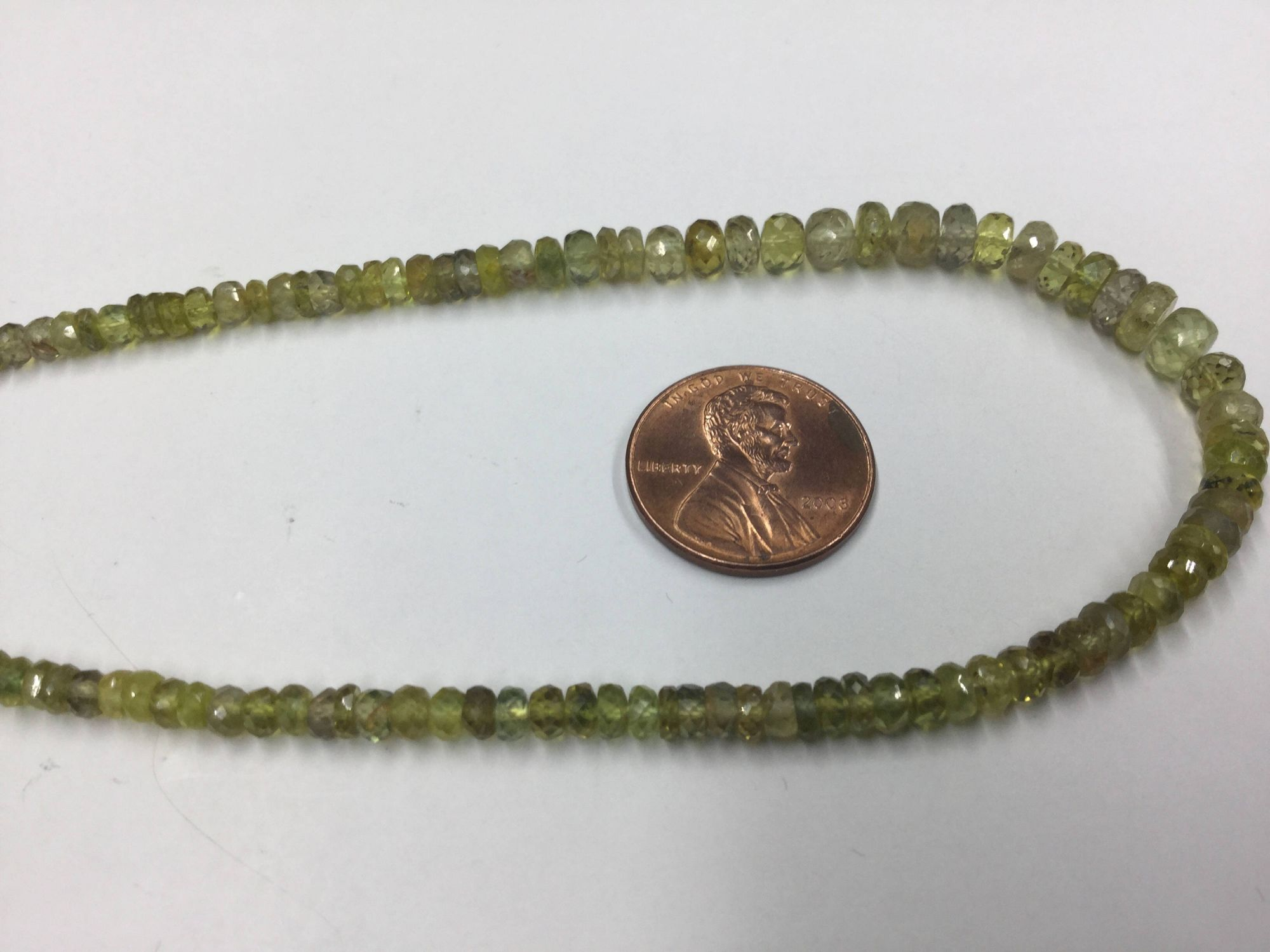 Yellowish Green Sapphire Rondelles Faceted